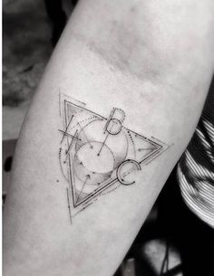 Fine line style triangle tattoo on the right forearm. Tattoo...