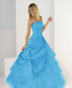 I like the skirt. Add some sleeves and it'd be a cute prom dress. (:
