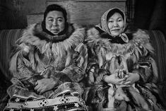 Toksook Bay, Alaska. Nick and Laura Therchik wear the handiwork of Laura's sewing. Their mountain-squirrel parkas kept them warm in the Roman Catholic Church where it was so cold the holy water froze. Don Doll, S.J. Photography