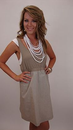 A preppy little dress with a unique layered look. $59