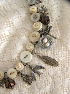 <3 Handmade Button Charm Bracelet Vintage Button Bracelet Altered  Charm Bracelet Antique Charm Bracelet. $36.50, via Etsy.