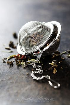 Tea strainer and loose leaf tea on a rustic wooden table. All ready for making #tea. #LooseLeaf