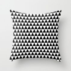 I just love all of the pillows (and shower curtains!) from this Etsy shop and this one is definitely my favorite. The bold black and white geometric design ...