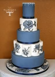 Painted peonies on this blue and white cake