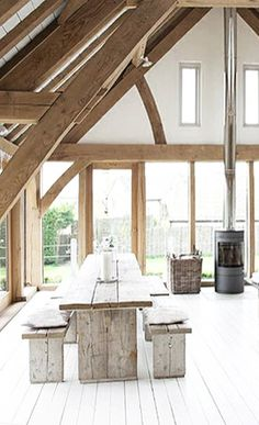 = wood beams, white floor, fireplace and wood dining