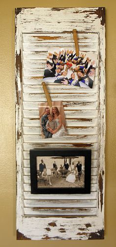 photos on old shutter ( love the old wood clothes pins to hold the pictures on )