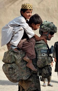 Our great American Soldiers can serve their Country under the worst of conditions, but still manage to show their compassionate side.