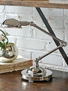Ideal for a desk or reading table, the Abel Task Lamp features an antiqued natural brass finish for added character and easily-movable neck for custom lighting.