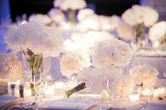 so pretty white flowers with little tea lights