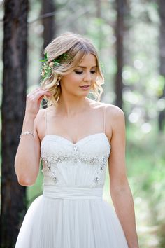 Romantic wedding dress with beaded bodice and pleated skirt | Lindy Yewen Photography | See more: http://theweddingplaybook.com/romantic-woodland-wedding-inspiration/