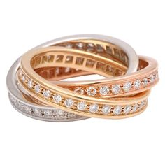 CARTIER, Trinity Diamond Ring  Cartier trinity ring in 18kt gold, pink, and white gold. The 3 interlocking rings are channel set with 90 diamonds, Color: F-G; Clarity: VS. The rings symbolize love, friendship and fidelity.   Retail: $13,000  Price  $9,750