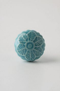 I absolutely LOVE these Granita Knobs from #anthropologie - they're adorable, and provide the perfect pop of color against our newly painted white cupboards.