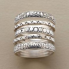 """Five sterling silver rings, each hand cast with a different motif based on Victorian carvings. Whole sizes 5 to 10. Approx. 1/2"""" wide worn together."""