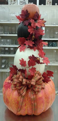 Floral Design, Stacked Pumpkin Topiary with an Orange Bow, 2013, Designed by Renee Corbin: Michael's of Waynesville, NC