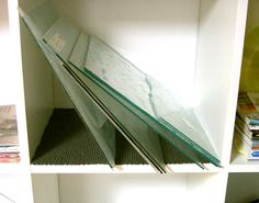 Sheet glass storage idea...self liner to keep it from sliding -- genius!