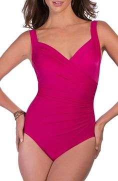 Free shipping and returns on Miraclesuit® 'Sanibel' Underwire One-Piece Swimsuit at Nordstrom.com. Look ten pounds lighter in ten seconds!® Surplice neckline and ruched side seams give a full-coverage underwire swimsuit a flattering shape. Triple-strength spandex smoothes the silhouette.