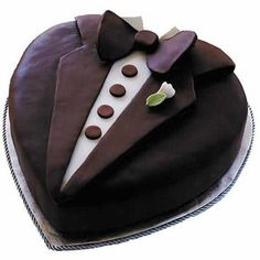 Tasteful Tux Cake - All dressed up and ready to go, this dapper cake will charm your guests. This cake is crafted using the Heart Pan Set and Ready-To-Use Rolled Fondant. Make the Boutonniere using the Step-Saving Rose Bouquet Flower Cutter Set.