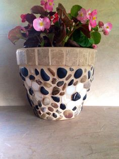A personal favorite from my Etsy shop https://www.etsy.com/listing/385175306/mosaic-planter-large-stone-flower-pot