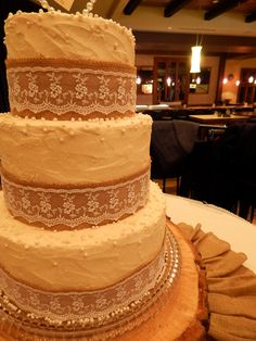 Burlap and Lace 3 tier Wedding Cake - Burlap and Lace, 3 tier rustic wedding cake for Audra and Brian! 10 inch, 8in and 6in, 2 layer rounds, all homemade buttercream with a rustic style technique with burlap, lace and edible pearls finishing it off!