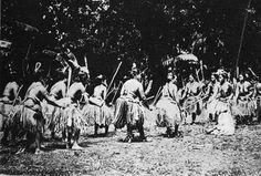 Stick Dance Palauan women's club, cheldebechel, dancing the bruchel dance performed only by women. Each side would represent a kebliil (clan). Belau National Museum photograph.