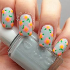 Looking for a feminine and fun nail design for #Easter? This floral manicure with a simple pastel blue-grey background fits the bill! #nailart #nails