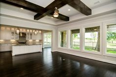 open floor plan with windows in back and windows in breakfast nook & covered back porch