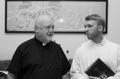 Paulist Fr. John Collins and Paulist seminarian Michael Cruickshank chatting before the Anniversary Mass on May 18, 2017. Photo by Joe Jenkins.