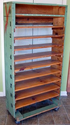 vintage rolling factory shelves... I know someone who could use this with cookie baking time!
