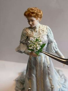 Lady in an Alice blue gown with bouquet- dollhouse miniatures
