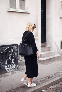 black coat, black bag, white sneakers