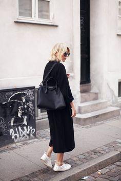 black coat, black bag, white sneakers
