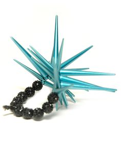 Spikes are an essential detail for this trend so add some color for a one-of-a-kind statement. #punk