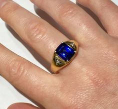 Art Deco style mens ring crafted in solid sterling silver with yellow gold over and set with man made - lab/synthetic blue Sapphire (verified) and two natural diamond accents on the sides. please see photos for a description. in good preowned condition. the sapphire shows no wear visible