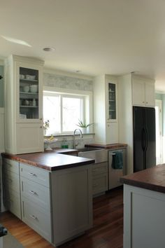 this could be my plan for the kitchen: glass fronts, white cabinets, butcher block  (or maybe soapstone?) counters, aluminum sink, marble tile backsplash.