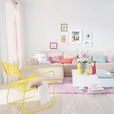 Love these white-washed floorboards and the frames wall art arrangement and colours, just random enough to work