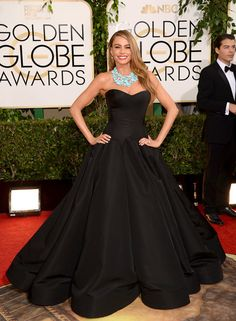 No mermaid silhouette? No bright color? Is this really Sofia Vergara wearing a black flared Zac Posen? Yes. Yes it is. It's full of drama which the comedy star owns. 71st Annual Golden Globe Awards.