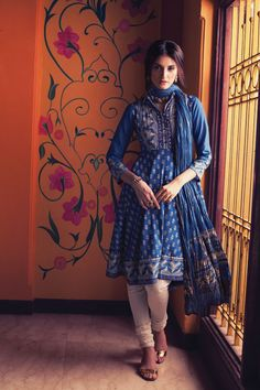 Set the trend in the stylishly chic printed assymetric flared kurta and dupatta with mirror work on yoke. Create a look that's distinctly yours.