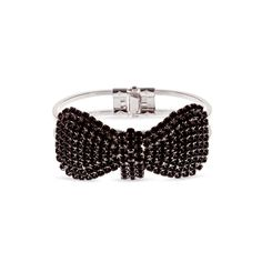 Tie a bow on your impeccable sense of style with the Josie bracelet. This sparkling bit of whimsy features black CZ's woven throughout shimmering silver for a sharp, tuxedo effect. Josie will stack well with bangles but you'll be tempted to let this one fly solo! Be prepared for compliments wearing this snazzy little cuff.  FInd it on Splendor Designs