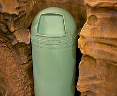 Tucked away within the rockwork of Tokyo DisneySea's Vulcania Restaurant, you'll find this green, bullet-shapped trash can. Talk about integrating garbage disposal into your theme... that's a tight fit! // Tokyo Disney Resort, Tokyo DisneySea, Mysterious Island, Vulcania Restaurant, 2013 [Source: Maihamazing. Used by permission.]Visit MagicalTrash.com • Follow on Twitter - Facebook - Google+