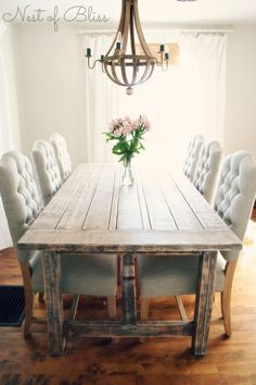 Rustic dining table with tufted Wicker Emporium dining chairs - Nest of Bliss