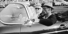 American actress Marilyn Monroe rides in a car with her husband, the American playwright Arthur Miller Monroe's friend, American photographer Milton Greene in New York, New York, They are driving in a 1956 Ford Thunderbird.