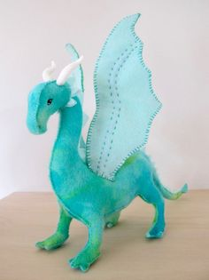 Hand Made Felt Dragon Toy or Ornament.  Made to order from 100% pure new wool felt which has been hand dyed.  Dragon is approx 18cm tall (from