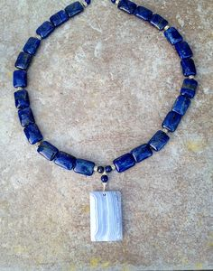 Lapis Lazuli rectangles with Blue Lace Chalcedony focal stone. Was $95 not on sale for $55! Click on this photo to learn about the amazing properties of Lapis Lazuli, a very calming gemstone.