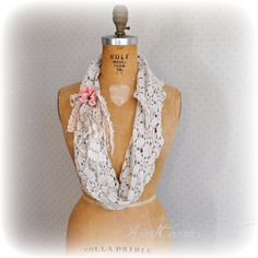This crochet lace infinity scarf is an ecru beige, long and easy to style into different looks. Made from fine vintage crochet. It has a notch