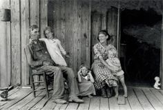 Couple with their three grand-daughters on the porch of a sharecropper shack in southeast Missouri. (1938) Missouri History Museum