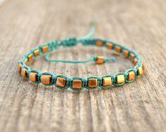 Single wrap macrame bracelet - Gold cubes on turquoise waxed cotton. $16,00, via Etsy.