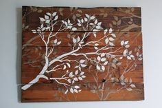 Homemade rustic artwork from old wood, paint and a stencil. You could make a stencil by cutting the pattern from wallpaper. Great if you have feature wallpaper and want some accent artwork for your other walls. Also works on canvas.