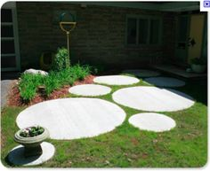 Different sizes of concrete circle stepping stones path.
