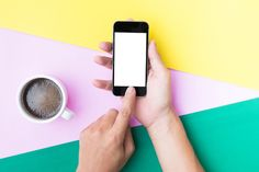 Flat lay hand using phone by ptystockphoto on @creativemarket