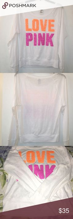 NWOT Victoria's Secret pink XS slouch long sleeve NWOT Victoria's Secret pink XS slouch long sleeve top white in color and perfect shape; writing in orange and pink rhinestones. Igor it fits but I don't like the way it falls off my shoulder so I took tags off. No flaws and perfect condition! Rehome me! PINK Victoria's Secret Tops Tees - Long Sleeve